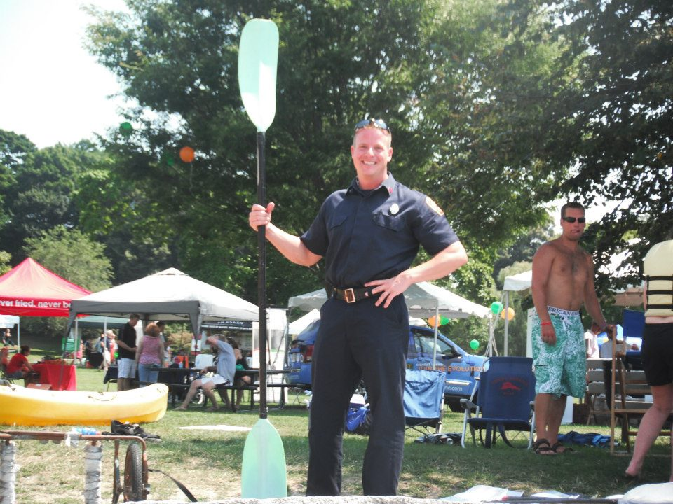 Officer holding a paddle